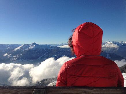 Austria, Alpbach Valley ski area, sitting on a bench - TKF000360