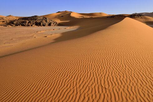 Africa, Algeria, Sahara, Tassili N'Ajjer National Park, Tadrart, Rocks and sand dunes at Oued in Djerane - ES001203