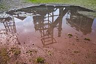 Germany, North Rhine-Westphalia, Dortmund-Hoerde, puddle with reflection of a blast furnace - WI000750