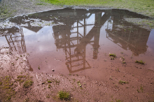 Germany, North Rhine-Westphalia, Dortmund-Hoerde, puddle with reflection of a blast furnace - WI000750