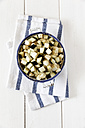 Bowl of diced aubergine on kitchen towel and white wood - EVGF000604
