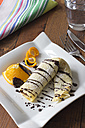 Pancake filled with chocolate cream on plate - YFF000169