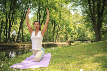 Germany, Woman exercising yoga in a park - VTF000278