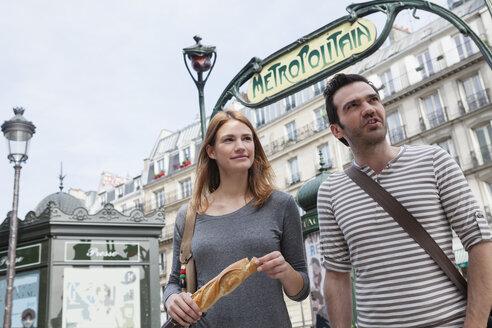 France, Paris, portrait of happy couple having fun - FMK001252