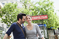 France, Paris, couple in front of Metro sign - FMKF001299