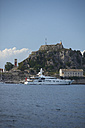 Greece, Ionic Islands, Corfu, yacht in front of the old fortress - AJF000065