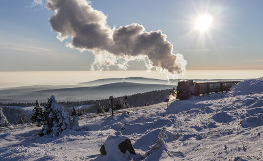 Germany, Saxony-Anhalt, Harz National Park, Brocken, Harz Narrow Gauge Railway in winter against the sun - PVC000008
