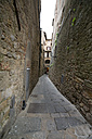Italy, Tuscany, Volterra, Houses and alley - MYF000395