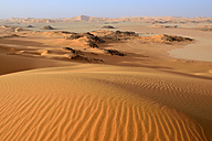 Africa, Algeria, Sahara, Tassili N'Ajjer National Park, Tadrart, Claypan and sand dunes at Oued in Djerane - ES001212