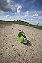 Italy, Tuscany, Province of Siena, Toy vespa on gravel road - MY000396