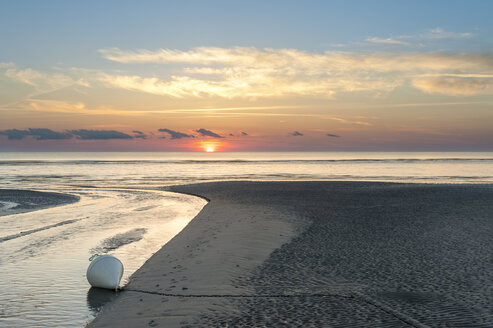 Germany,Schleswig-Holstein, North Sea, Beach of Sankt Peter-Ording in sunset, Buoy - RJF000190