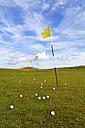 United Kingdom, Scotland, Highlands, Yellow flags on golf course - LYF000083