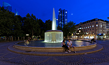 Germany, Hesse, Frankfurt, Opera Square with fountain in the evening - AM002396