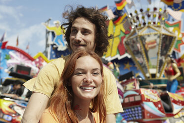 Happy young couple on a funfair - RHF000356