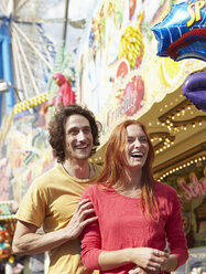 Happy young couple on a funfair - RHF000365