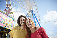 Happy young couple on a funfair - RHF000368