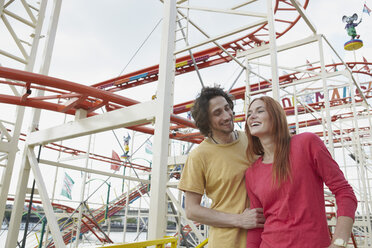 Happy young couple on a funfair - RHF000381