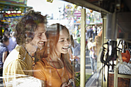 Happy young couple on a funfair - RHF000377