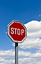 Switzerland, Stop sign and blue sky with clouds - AMF002403