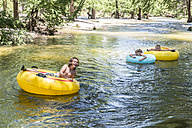USA, Texas, Children tubing the Frio River - ABAF001400