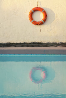 Spain, Canary Islands, La Palma, life saver hanging on wall behind swimming pool - SEF000746