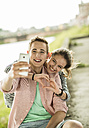 Happy young couple taking a selfie with smartphone - UUF001027