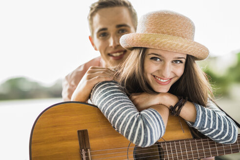 Portrait of young couple with guitar - UUF001051