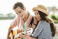 Portrait of young couple with guitar - UUF001056