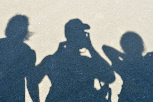 New Zealand, Nelson, shadows of three people on the sand - SHF001492