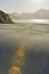 New Zealand, Golden Bay, Wharariki Beach, wind patterns and reflections in a sand dune - SHF001460