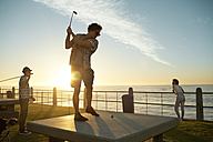 Friends playing urban golf at the coast - VVF000112