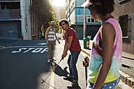 Friends playing urban golf in the city - VVF000114