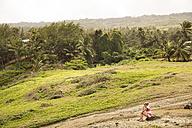 Caribbean, Barbados, Bathsheba, woman sitting in rural landscape - SKF001554