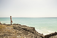 Caribbean, Barbados, woman at the coast - SKF001561
