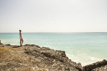 Caribbean, Barbados, woman at the coast - SKF001561