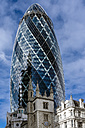 England, London, City of London, view to Swiss Re Tower and  St Andrew Undershaft in the foreground - WEF000164