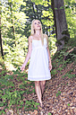Portrait of a young woman wearing white dress standing in the forest - VTF000312