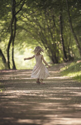 Little girl dancing on forest track - MW000053