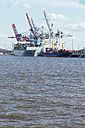 Germany, Hamurg, ship and cranes at container terminal Tollerort - KRP000613