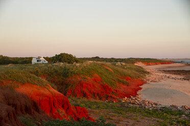 Australia, Western Australia, Camper van on beach near Broome at sunset - MBEF001030