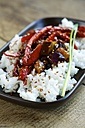 Sweet and sour eggplant with red Pepper on rice and garnished with sesame seeds - HAWF000337