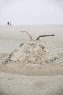 Germany, Lower Saxony, East Friesland, Langeoog, sand castle formed as an alien - JATF000743