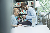 Two students in a university library - WESTF019719