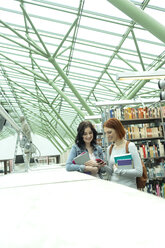 Two students in a university library - WESTF019732