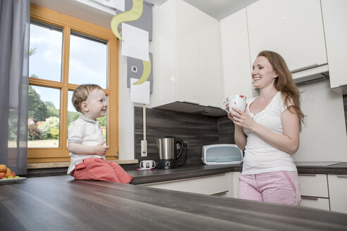 Mother with baby boy in kitchen - VTF000330
