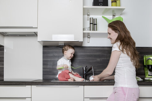 Mother with baby boy in kitchen - VTF000333