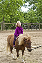 Little girl riding on pony - JFE000461