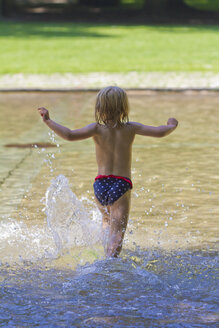 Little girl running into a pond - JFEF000415