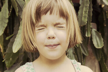 Portrait of little girl with closed eyes pouting mouth - LVF001491