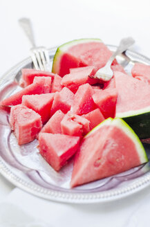 Plate of pieces of watermelon and two forks - CZF000156